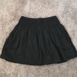 Bebe black mini skirt with pockets